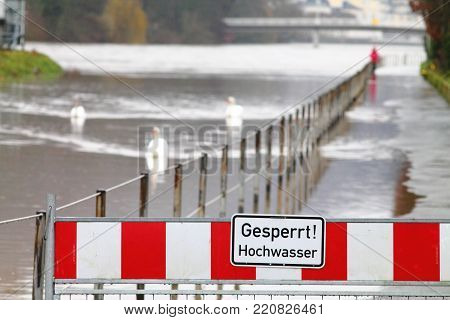 High Water Warning Street Barrier On River Lahn In Germany. Spa Town Embankment Under Water.