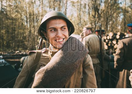 Gomel, Belarus - April 23, 2017: Portrait Of Young Smiling Unidentified Re-enactor Dressed As Soviet Russian Red Army Infantry Soldier Of World War II