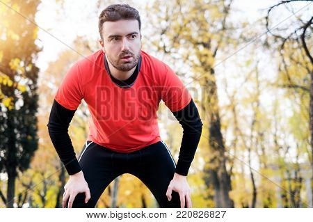 Injury Running Concept . Man Having Knee Pain While Training