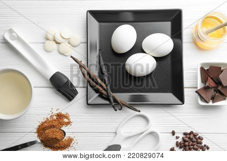 Ingredients and utensils for cooking pastries on wooden background