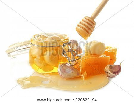 Composition with honey and garlic as natural cold remedies on white background