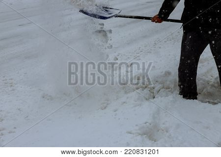 Man cleaning snow from a walkway with copy space Man Removing Snow with a Shovel
