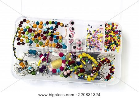making bracelets and necklaces from colorful beads, wonderful handicraft for children, colorful beads and bracelets,