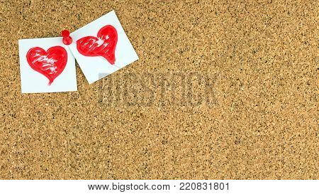 Valentines day background. There are two red brushed hearts on white pieces of paper pinned on the upper left  corner conner of cork brown board for notes, empty place for text on the center. The red button has used.