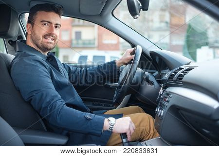 Man At The Wheel Of His Brand New Car