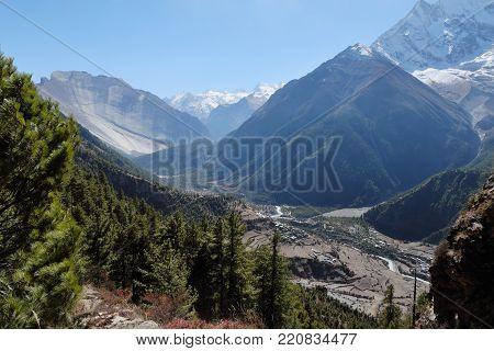 Huge mountain valley in nepal himalayas with enormous rock Sworgadwari
