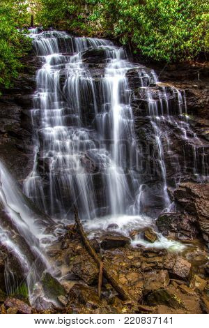 North Carolina Waterfall. Scenic Soco Falls in Maggie Valley, North Carolina in vertical orientation.