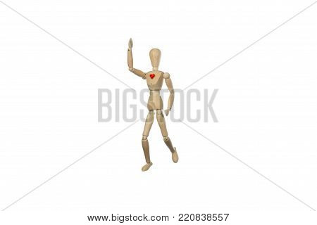 wooden mannequin walking with a red heart, conceptual photo about  healthy lifestyle practicing a sport