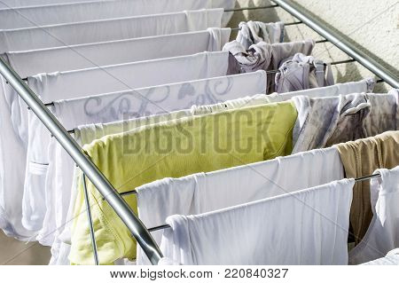 Fabrics are left to dry on the balcony,drying clothes in the laundry drying,
