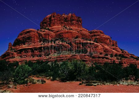 Sedona's Bell Rock under Moonlight viewed from its south side. This landmark is located in Arizona.