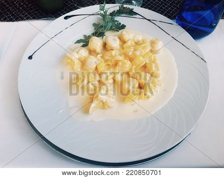 Ravioli dish stuffed with pear with gorgonzola sauce. exquisite