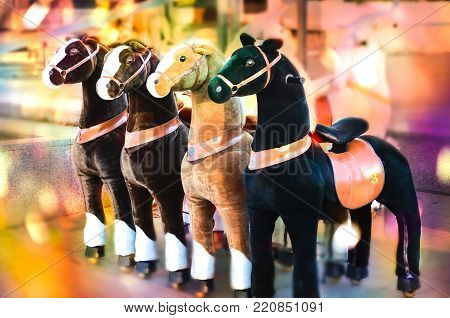Toy stand with horses on wheels and other animals with color effects