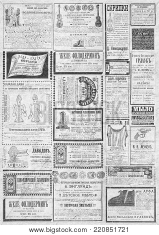 Vintage newspaper texture. A newspaper vertical  background illustration with advertisements from a vintage old Russian newspaper of 1893. Gray old paper collage background.