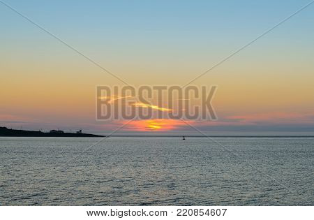 Brier Island with Northern Light & Alarm Lighthouse on the background during the sunset (Brier Island, Nova Scotia, Canada)