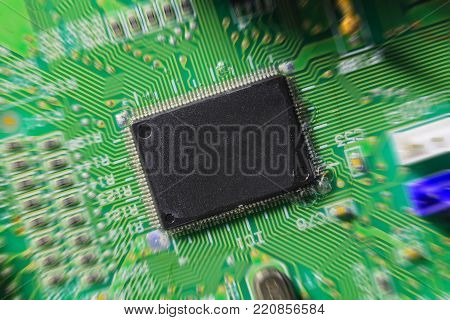 Computer chip on green electronic circuit board or printed circuit board-PCB with electronic components. Technology concept.