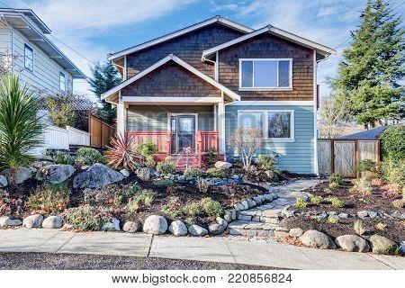 Nice Craftsman Home Exterior On Blue Sky Background