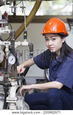 young asian woman engineer set up and testing machine in the laboratory factory, engineering and industrial concept