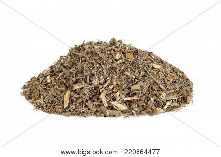 Wormwood leaf herb used in alternative herbal medicine to treat anorexia, indigestion and anemia. An ingredient in the spirit absinthe. On white wood background. Artemesia absinthium.