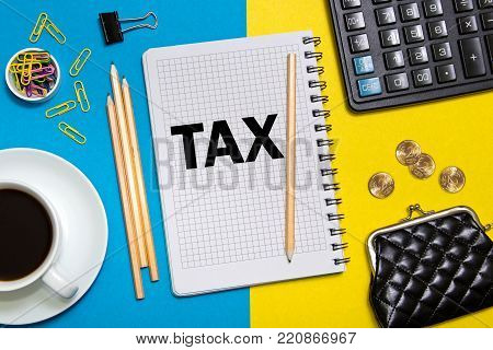 TAX notes in the notebook on the Desk of a businessman in office. Business concept TAX. Template TAX with space for caption,  text.