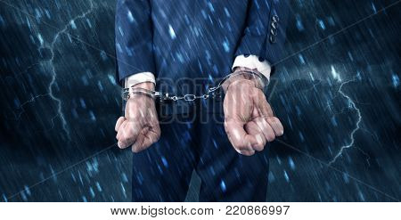 Stormy bad day concept with close handcuffed elegant man