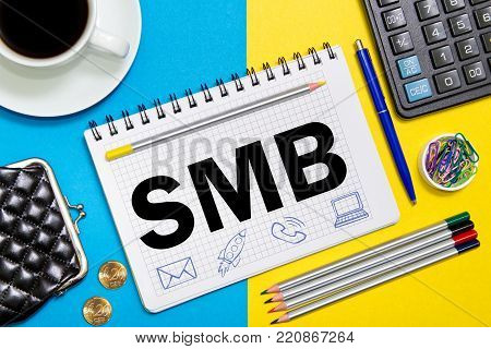 SMB notes in the notebook on the Desk in the office Desk. Business concept Small and Medium Sized Business