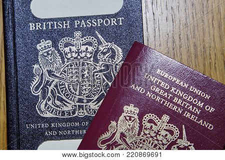 London, Uk: January 04, 2018: An Old Blue British Passport Under A New Red European Union Passport.