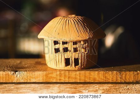 Small house made of clay as souvenir and household decoration.