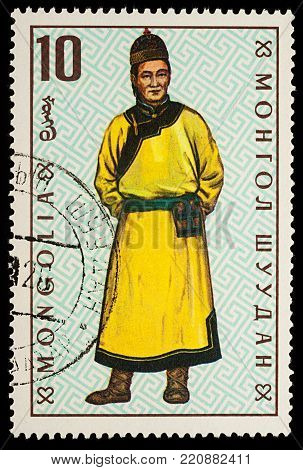 Moscow, Russia - January 06, 2018: A stamp printed in Mongolia, shows Man in traditional Mongolian costume, Torgut, series