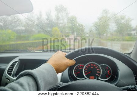 Driving in hard weather conditions, rain on the windshield, Drive in very foggy weather. There are heavy fog on the day of driving and need to be careful in controlling the car.