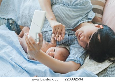 family communication chat smartphone newborn concept. say 'hi' to daddy. family online conversation. together despite the distance