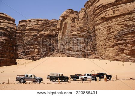 Wadi Rum, Jordan - Apr 21, 2014: Touristic Jeeps For The Tourists In The Valley Of Laurence Of Arabi