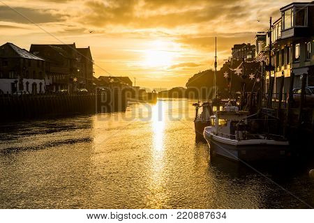 Looe River At Sunrise, With Golden Sun ,cornwall, Uk