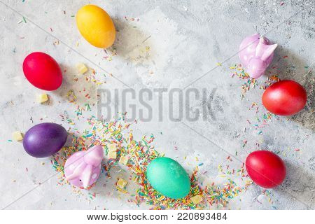 Easter Background. Colorful Background Of Easter With Colored Eggs On A Concrete Background With Cop