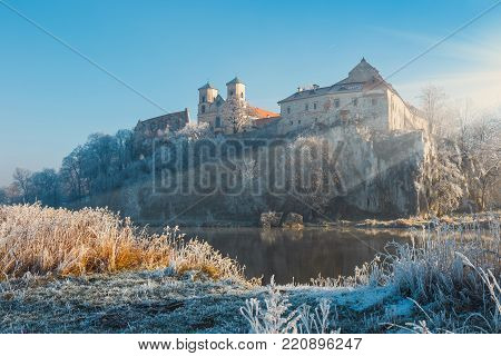 Hoarfrost on the grass and the benedictine abbey in Tyniec in the background, Poland