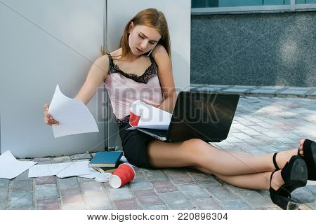 hardworking business woman make a deal by the phone. lack of time and energy for the job. successful entrepreneur