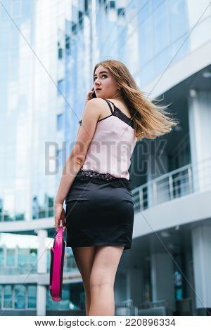rush successful business woman in the big city. deal by the smartphone. lifestyle of hardworking people.