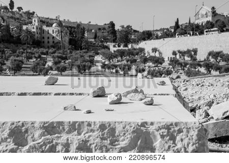 Black and white picture of tomb in the ancient Jewish Cemetery located in the Mount of Olives in Jerusalem, Israel.