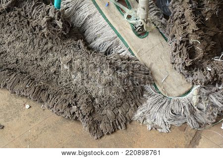 old ragged and mops on cement ground