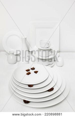 Restaurant white tableware assortment. Stylish crockery set. Purity and luxury concept
