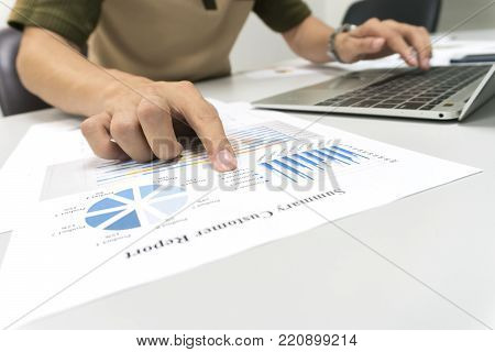 Business man calculate about cost and doing finance at office, Finance managers task,Concept business and finance investment