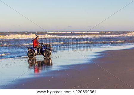 Kijkduin, The Hague, the Netherlands - 7 January 2017: quad biker doing topographic beach survey