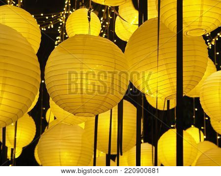 Traditional Chinese new year lantern or round ceiling lamp yellow. Yellow bright light.