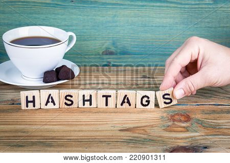 hashtags. Wooden letters on the office desk, informative and communication background.