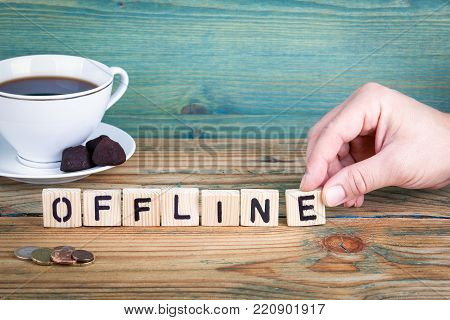 offline. Wooden letters on the office desk, informative and communication background.