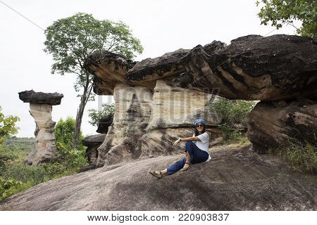 Asian Travelers Thai Women Travel And Posing At Sao Chaliang Or Rock Earth Pillar In Pha Taem Nation
