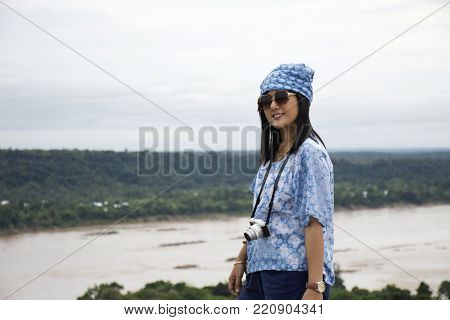 Thai Women Travel And Posing At Viewpoint Of Pha Taem National Park In Ubon Ratchathani, Thailand