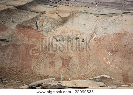 Rock Art Includes Both Humanoid And Animal Figures On Cliffs At Pha Taem National Park In Ubon Ratch