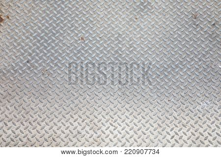 Background of rusty metal diamond pattern plate