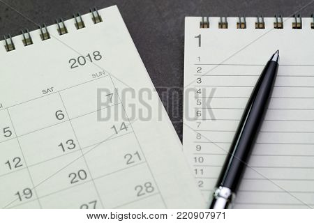 Year 2018 to do list concept by notepad with list number and pen on calendar.