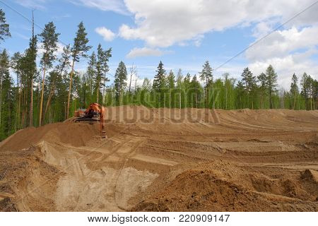 Big excavator in action on construction site